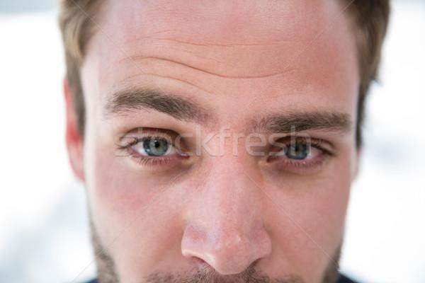 Handsome man looking at the camera Stock photo © wavebreak_media