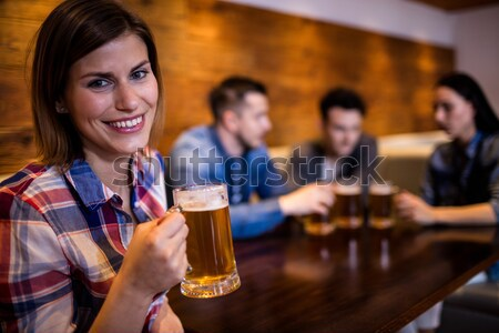 Friends toasting glass of beer in bar Stock photo © wavebreak_media