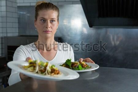 Female chef using digital tablet Stock photo © wavebreak_media