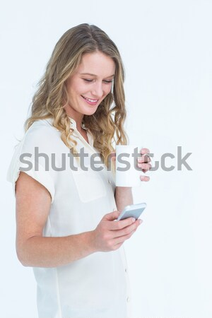 Young woman text messaging on mobile phone Stock photo © wavebreak_media