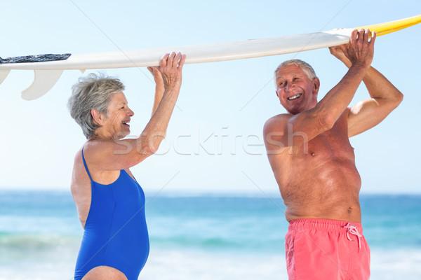 Aranyos érett pár tart szörfdeszka tengerpart Stock fotó © wavebreak_media