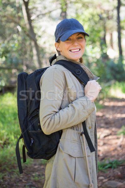 Smiling woman with backpack Stock photo © wavebreak_media