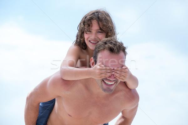Hijo ojos equitación padre playa atrás Foto stock © wavebreak_media