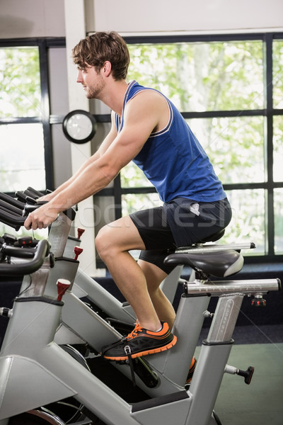 Man working out on exercise bike at spinning class Stock photo © wavebreak_media
