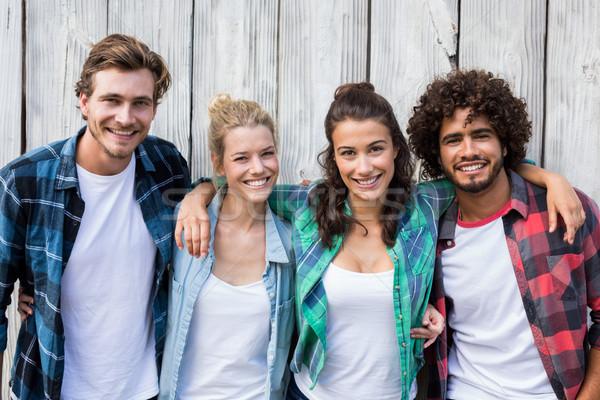 Friends standing with arms around Stock photo © wavebreak_media