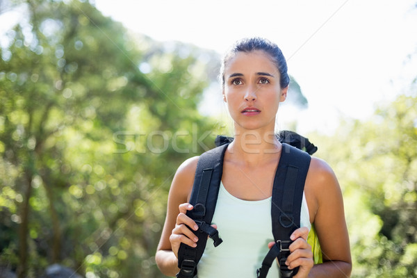 Woman unsmiling posing with her backpack  Stock photo © wavebreak_media