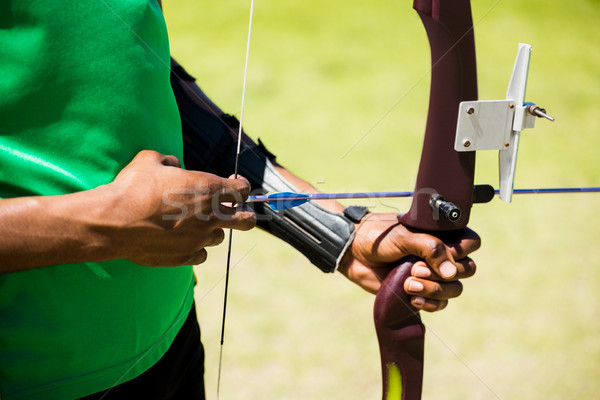 Mid section of athlete practicing archery Stock photo © wavebreak_media
