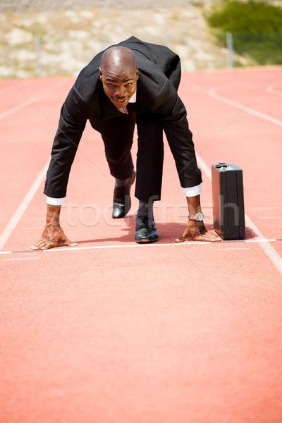 Businessman with briefcase ready to run Stock photo © wavebreak_media