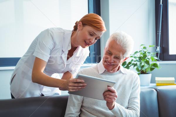 Nurse and senior man using a digital tablet Stock photo © wavebreak_media