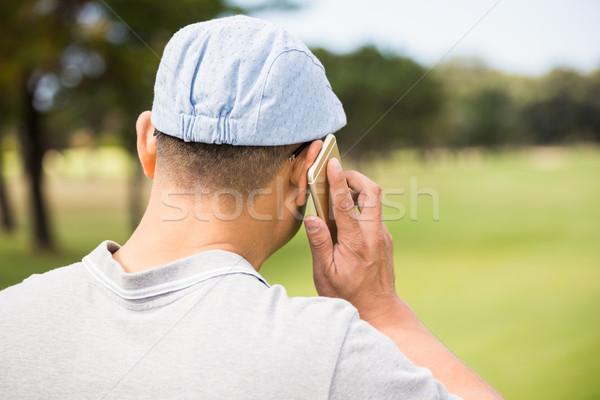 Vista posteriore golfista chiamando cellulare telefono sport Foto d'archivio © wavebreak_media