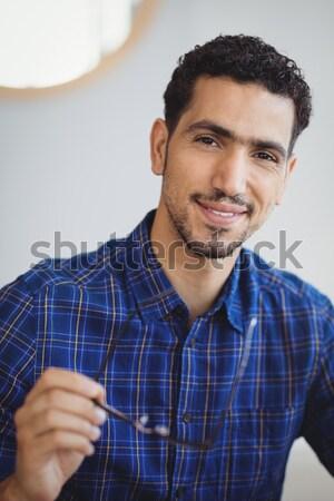 Mid adult man standing against white background Stock photo © wavebreak_media