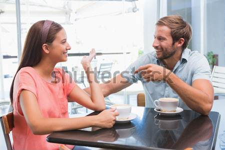 Para trzymając się za ręce kawiarnia uśmiechnięty tabeli człowiek Zdjęcia stock © wavebreak_media