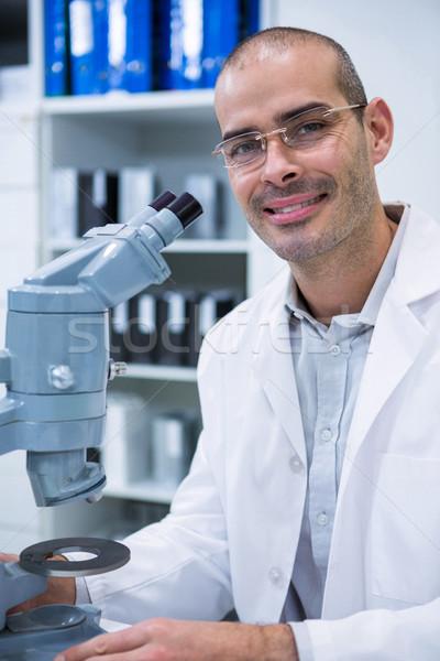 Sonriendo masculina optometrista microscopio retrato oftalmología Foto stock © wavebreak_media