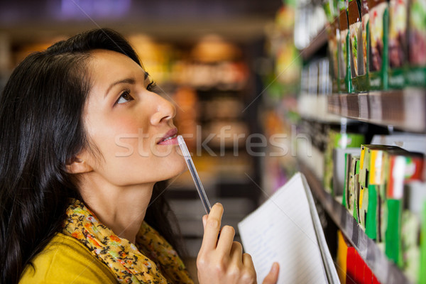 Thoughtful woman shopping for grocery Stock photo © wavebreak_media