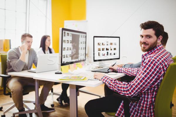 Portrait of happy editor working at creative office Stock photo © wavebreak_media