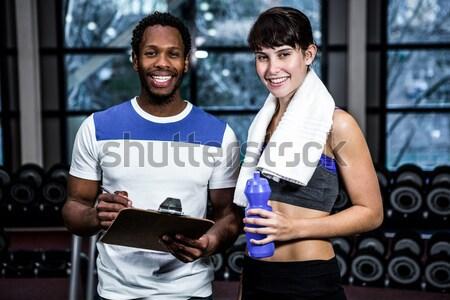 Portrait of happy fitness instructor with man  Stock photo © wavebreak_media