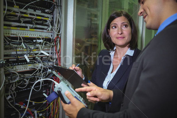 Technicians interacting with each other while analyzing server Stock photo © wavebreak_media