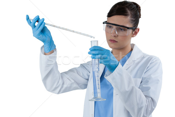 Female scientist conducting an experiment Stock photo © wavebreak_media