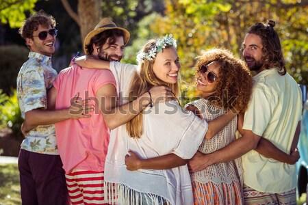 Férfiak háton nők park napos idő szeretet Stock fotó © wavebreak_media