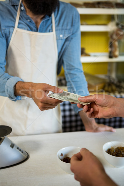 Customer paying bill by cash at meat counter Stock photo © wavebreak_media