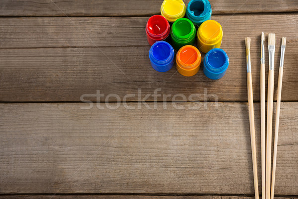 Paintbrush and watercolors arranged on wooden surface Stock photo © wavebreak_media