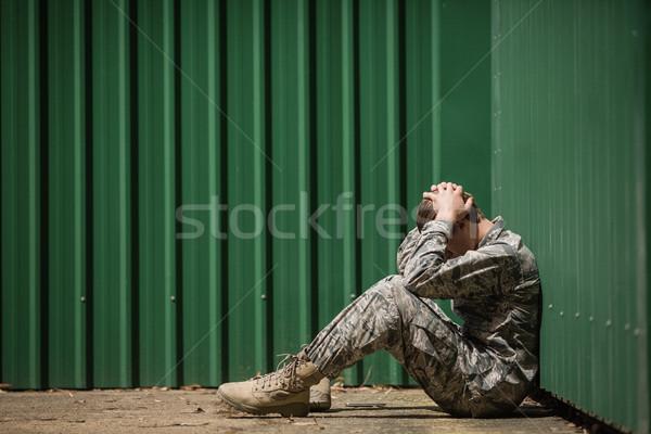 Csalódott katonaság katona ül kezek fej Stock fotó © wavebreak_media