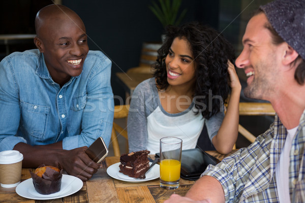 Friends talking at table in coffee house Stock photo © wavebreak_media