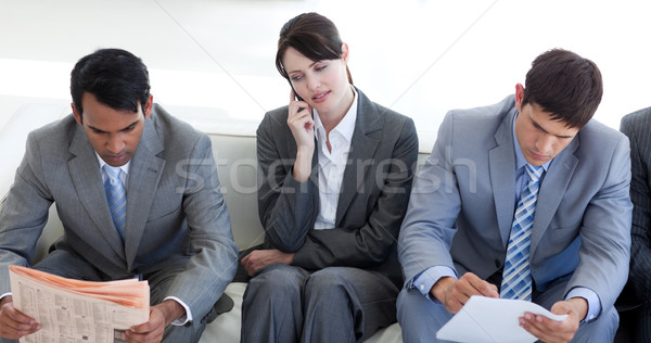 Stock photo: Serious Business people sitting and waiting for a job interview
