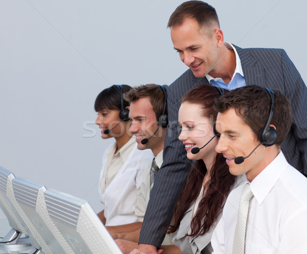 Attractive manager checking his team work in a call center Stock photo © wavebreak_media