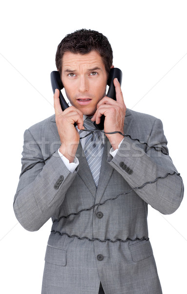 Stressed businessman tangle up in telephone wires Stock photo © wavebreak_media