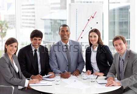 Magasról fotózva sokoldalú üzleti csoport gyűlés iroda számítógép Stock fotó © wavebreak_media