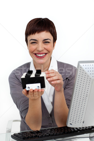 Smiling businesswoman holding a business card holder  Stock photo © wavebreak_media