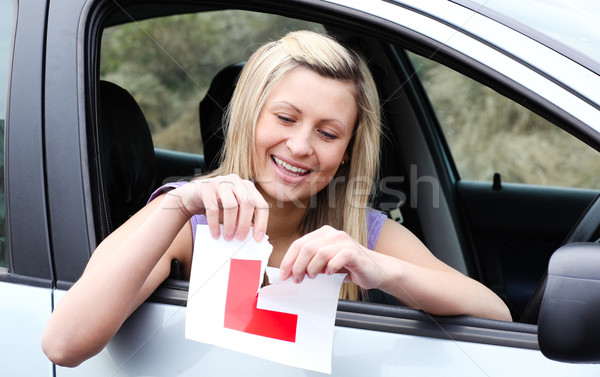 Happy young female driver tearing up her L sign  Stock photo © wavebreak_media