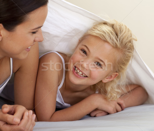 Mother and daughter playing under the bedsheets Stock photo © wavebreak_media