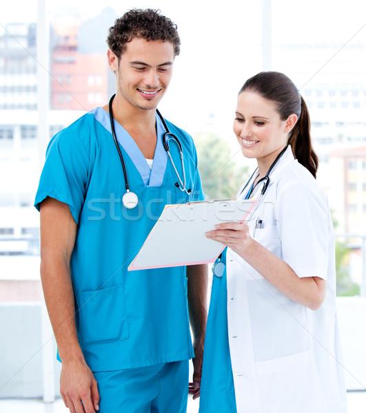 Feliz médico parceria olhando diagnóstico hospital Foto stock © wavebreak_media