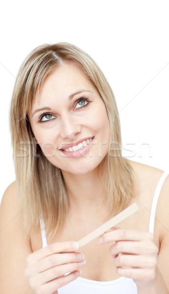 Portrait of a pensive woman filing her nails Stock photo © wavebreak_media