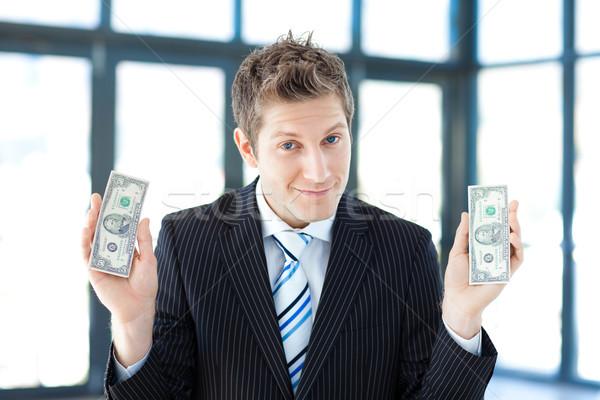 Empresário dólares jovem negócio contato Foto stock © wavebreak_media