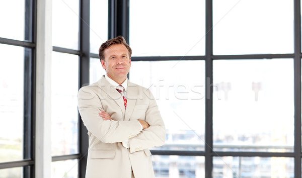 Business manager with folded arms looking at the camera Stock photo © wavebreak_media