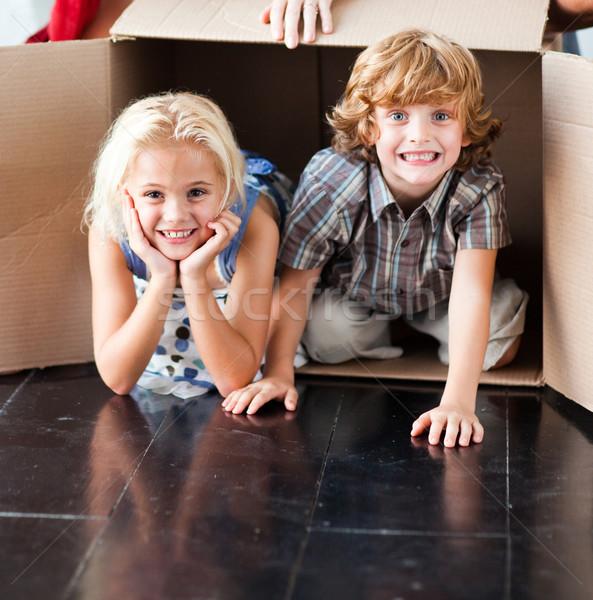 Gyerekek szórakozás új ház család mosoly boldog Stock fotó © wavebreak_media