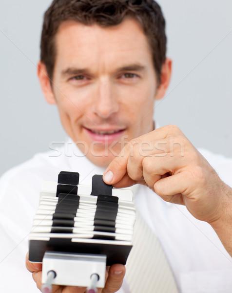 Attractive businessman holding a card holder Stock photo © wavebreak_media