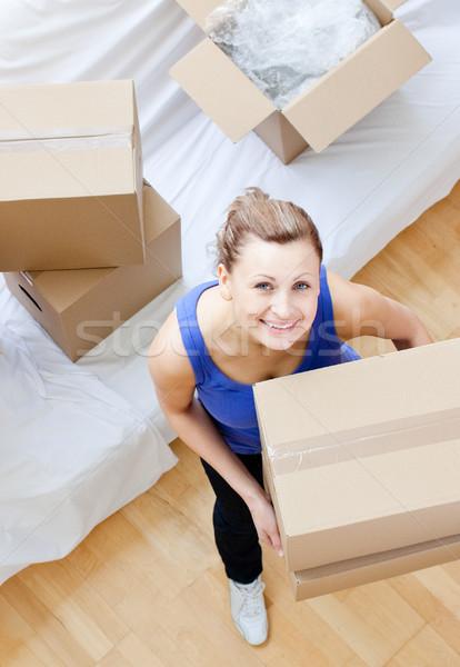Radiant woman holding a box Stock photo © wavebreak_media