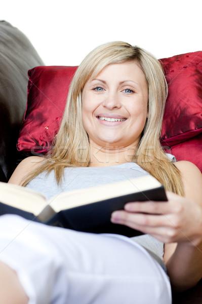 Cute женщину книга диван улыбка Сток-фото © wavebreak_media