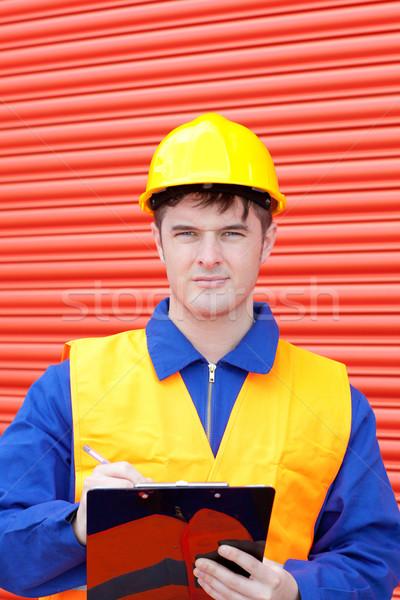 Confident worker writing on a clipboard Stock photo © wavebreak_media
