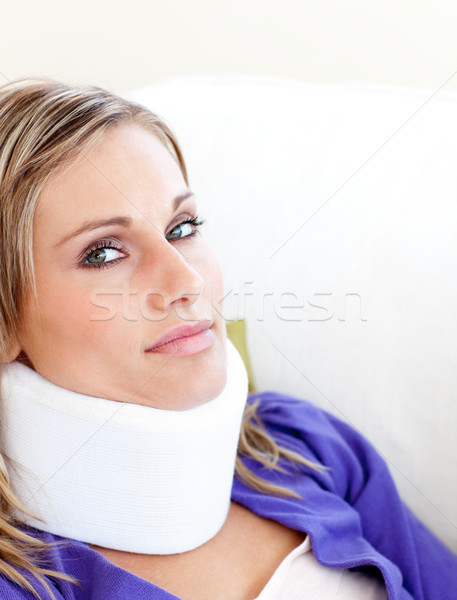Young woman with a neck brace looking in the camera against white background Stock photo © wavebreak_media
