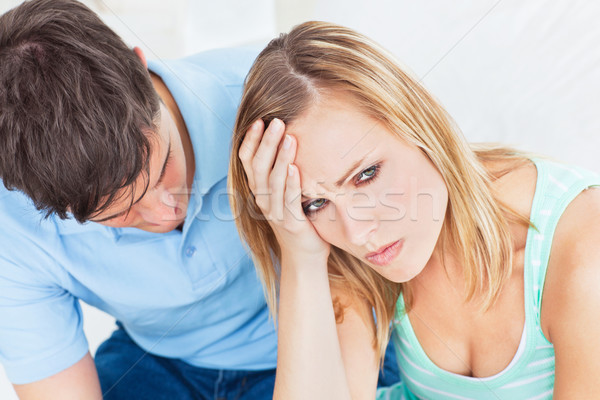Homem bonito argumento namorada sessão sala de estar homem Foto stock © wavebreak_media