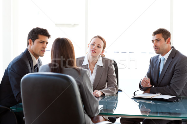 Rear view of a businesswoman being interviewed by three executives sitting around a table Stock photo © wavebreak_media