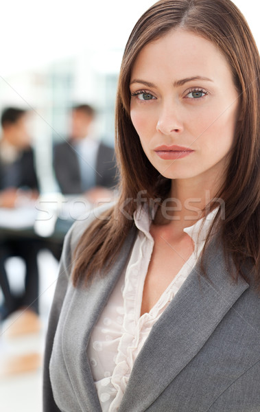 Charismatic businesswoman in the foreground while his colleagues working in the office Stock photo © wavebreak_media