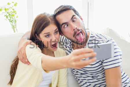 Cheerful couple with a pregnancy test in the bedroom at home Stock photo © wavebreak_media