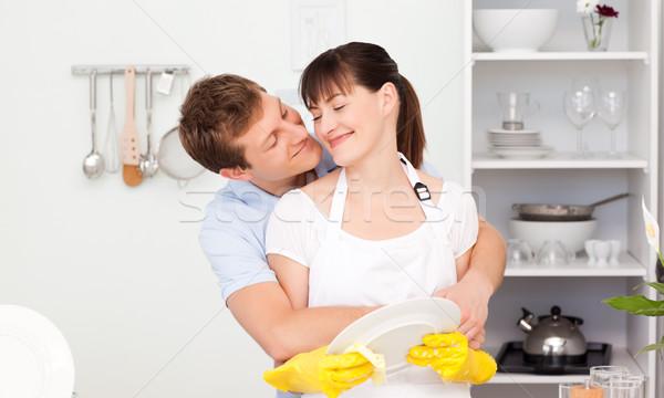 Jóképű férfi ölel feleség konyha nő víz Stock fotó © wavebreak_media