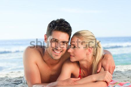 Happy lovers at the beach Stock photo © wavebreak_media